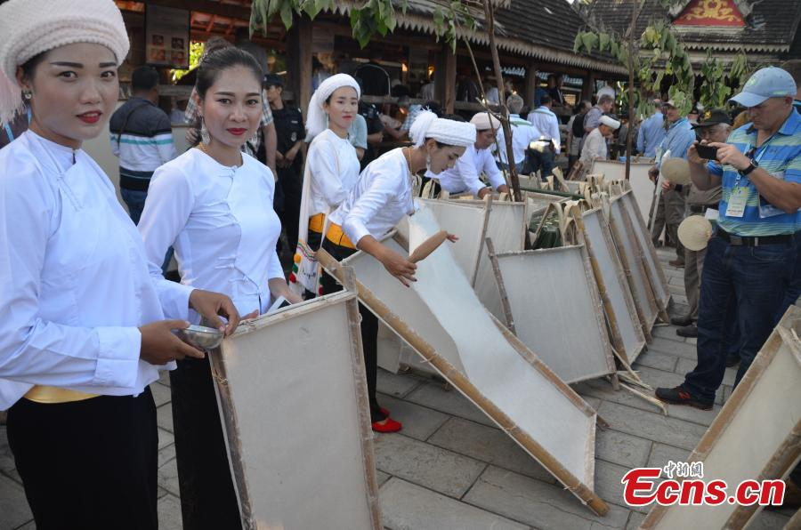 Women of Dai ethnic group show traditional paper-making craft, using a kind of bark as raw material, at Mengtuan Village in Lincang City, Southwest China's Yunnan Province, Oct. 15, 2018. The paper-making technique dated from 600 years ago and was listed as a national intangible cultural heritage in 2006. (Photo: China News Service/Miao Chao)