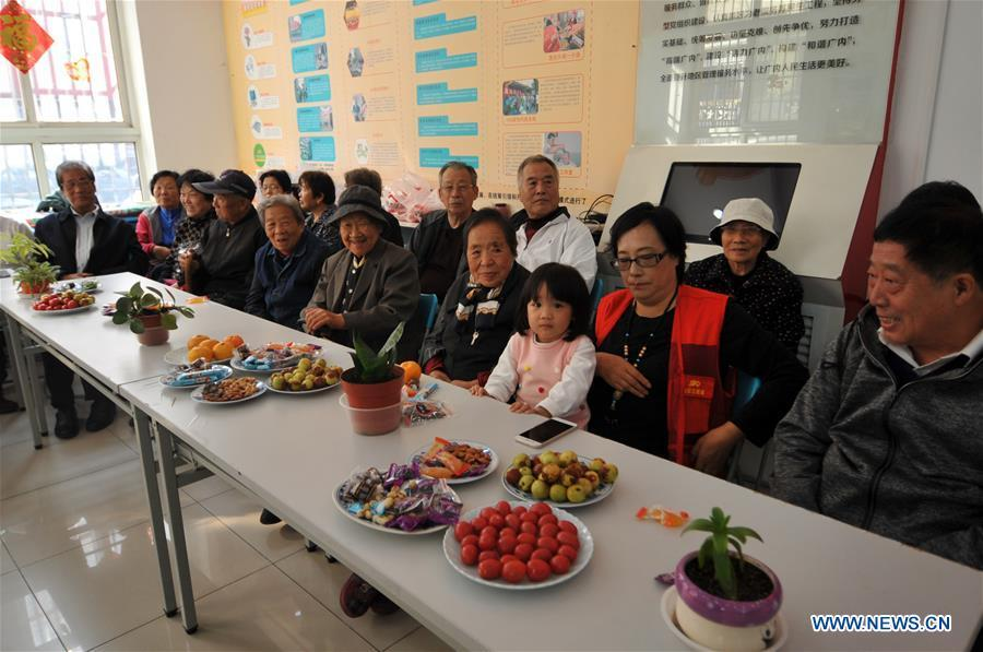 Residents gather in Hetaoyuan community of Xicheng District in Beijing, capital of China, Oct. 16, 2018. Senior residents in the community got together to watch a performance celebrating the upcoming Chongyang Festival, a day to pay respect to seniors that falls on the ninth day of the ninth lunar month, which is on Oct. 17 this year. (Xinhua/Zhao Yusi)