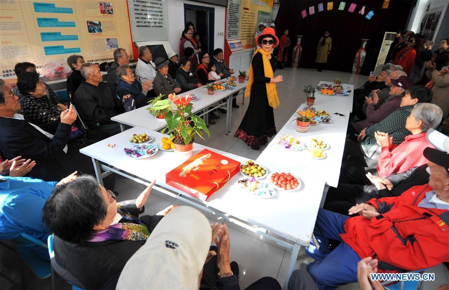 Residents watch a performance in Hetaoyuan community of Xicheng District in Beijing, capital of China, Oct. 16, 2018. Senior residents in the community got together to watch a performance celebrating the upcoming Chongyang Festival, a day to pay respect to seniors that falls on the ninth day of the ninth lunar month, which is on Oct. 17 this year. (Xinhua/Zhao Yusi)
