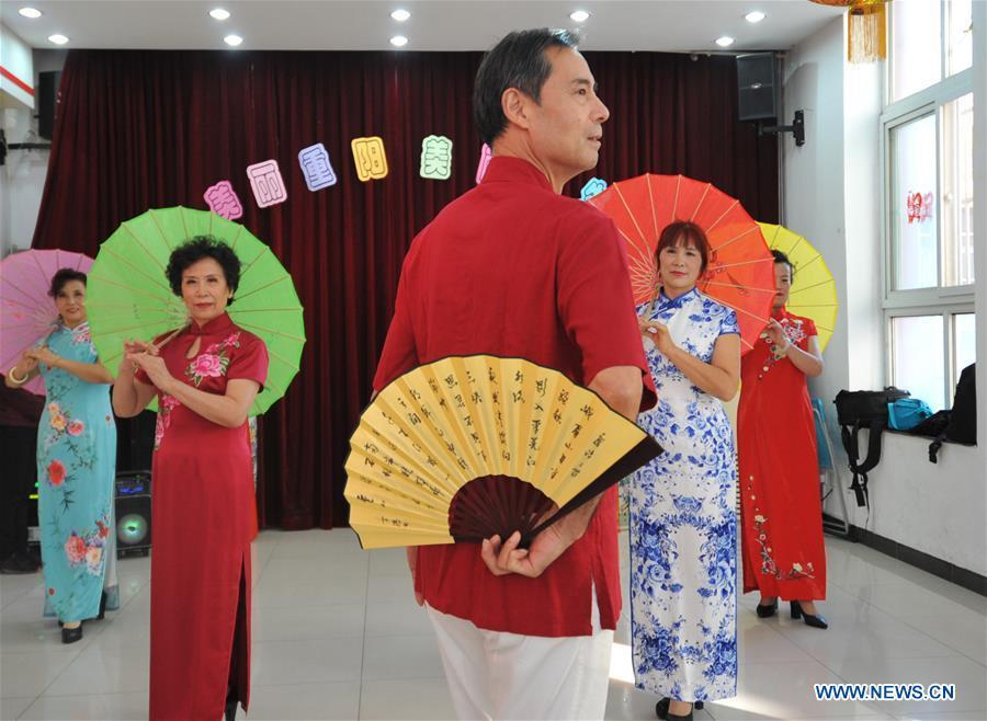 Senior residents perform in Hetaoyuan community of Xicheng District in Beijing, capital of China, Oct. 16, 2018. Senior residents in the community got together to watch a performance celebrating the upcoming Chongyang Festival, a day to pay respect to seniors that falls on the ninth day of the ninth lunar month, which is on Oct. 17 this year. (Xinhua/Zhao Yusi)