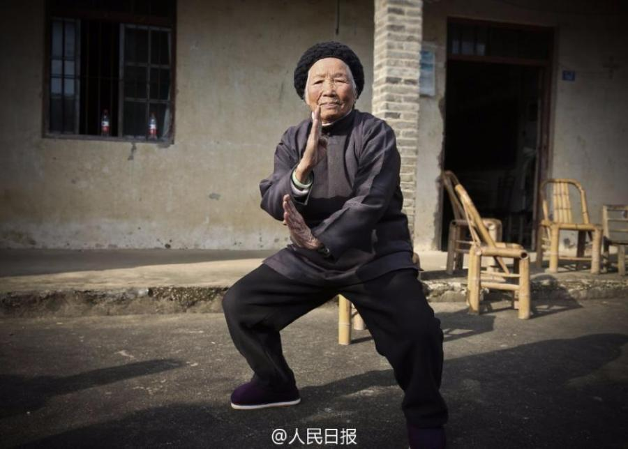 Zhang Hexian, 94, teaches kung fu in Liyang Town in Ningbo City, East China's Zhejiang Province. Zhang said she started to learn kung fu at four years old and has kept up her practice for 90 years. She excels in using fists and legs, and her best weapon is sticks. Today she is remains healthy and maintains good daily routines. It\'s said her skills have enabled her to challenge the local bully and put other rascals in their place. (Photo/Weibo of People's Daily)