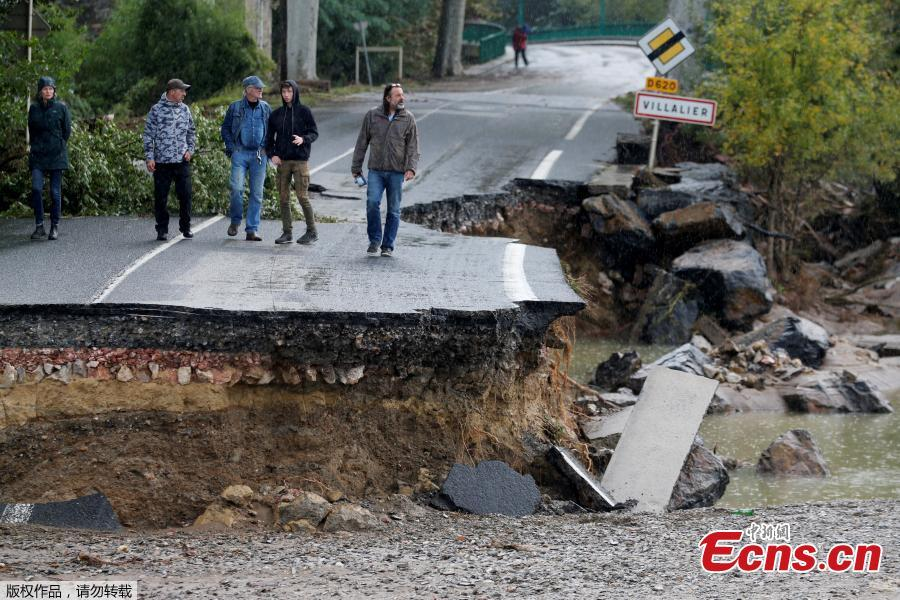 A road partially washed away after flash floods hit the southwestern Aude district of France after several months\' worth of rain fell in just a few hours overnight, in Conques, France, Oct. 16, 2018. At least 12 people died. (Photo/Agencies)