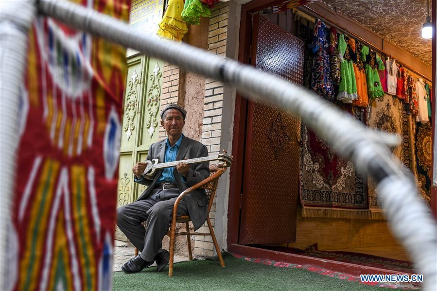 A man plays a traditional musical instrument at home in Kashgar City, northwest China\'s Xinjiang Uygur Autonomous Region, Oct. 16, 2018. The ancient oasis city of Kashgar, in the westernmost part of China near the border with Kyrgyzstan, Tajikistan, Afghanistan, and Pakistan, was an important staging post on the original Silk Road and has been revitalized as a bustling hub of business and different cultures. (Xinhua/Hu Huhu)