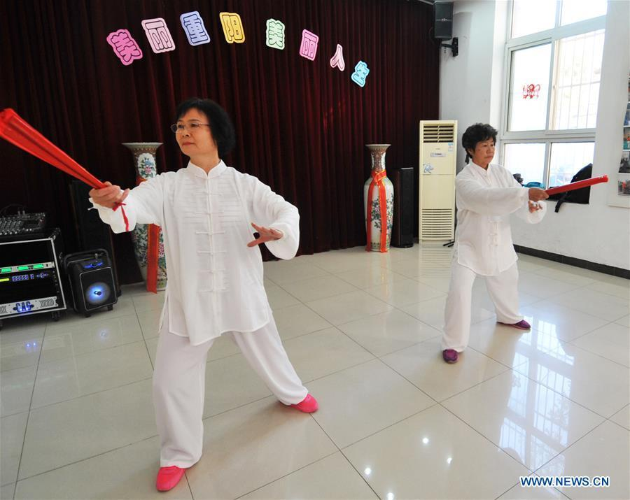 Two senior residents perform Tai Chi in Hetaoyuan community of Xicheng District in Beijing, capital of China, Oct. 16, 2018. Senior residents in the community got together to watch a performance celebrating the upcoming Chongyang Festival, a day to pay respect to seniors that falls on the ninth day of the ninth lunar month, which is on Oct. 17 this year. (Xinhua/Zhao Yusi)