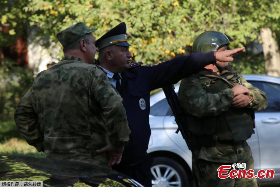 Military and police near the site of an alleged attack at a vocational school in Kerch in Crimea, Oct.17, 2018. At least 19 people have been killed and dozens injured in a mass shooting at the college. (Photo/Agencies)