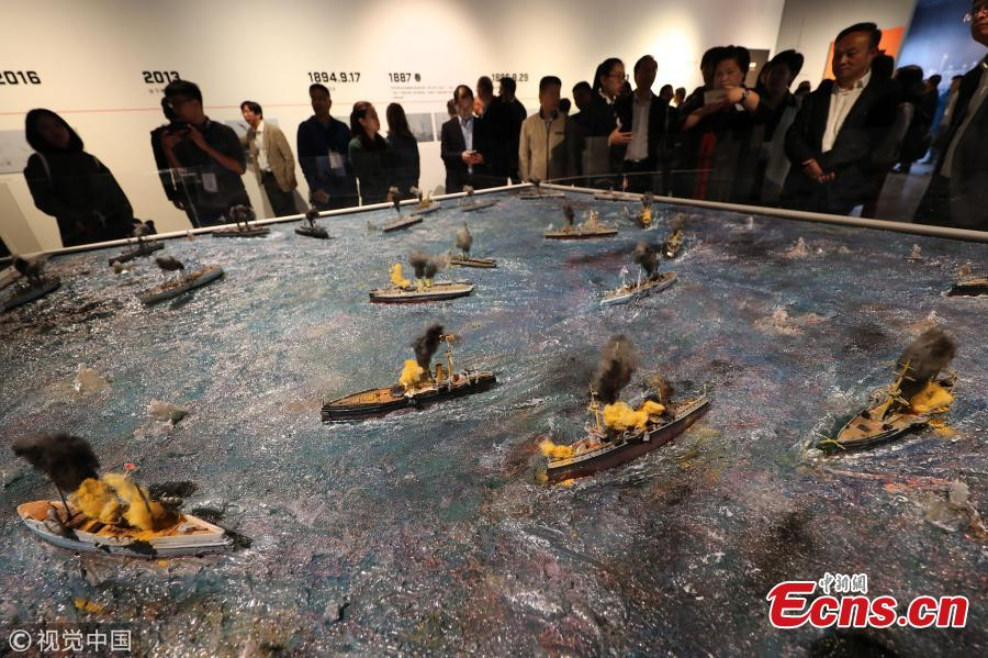 An exhibition on the Zhiyuan, a warship sunk by the Japanese navy in 1894 in the Battle of the Yellow Sea during the Sino-Japanese War, opens at the China Port Museum in Ningbo City, East China's Zhejiang Province, Oct. 17, 2018. The exhibition shows the warship's history and the discovery of the shipwreck near Dandong Port in Northeast China. (Photo/VCG)