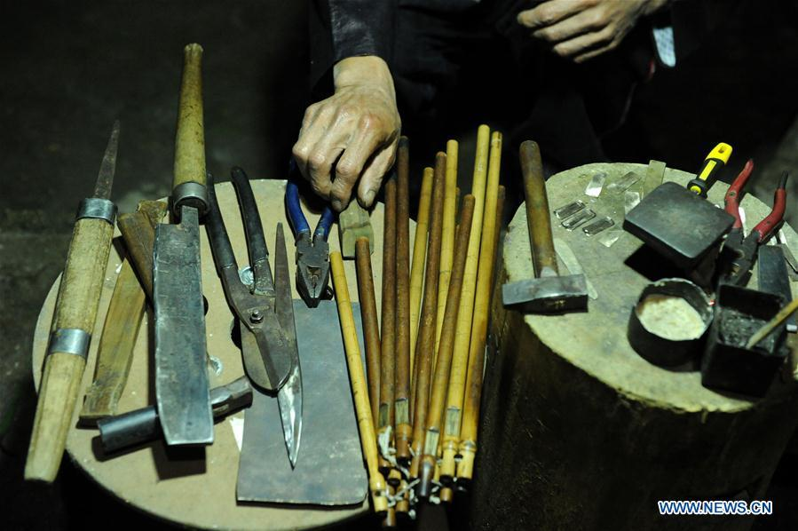 Tools for making Lusheng are seen at Jinying Village in Congjiang County of Miao and Dong Autonomous Prefecture of Qiandongnan, southwest China\'s Guizhou Province, on Oct. 16, 2018. Lusheng is an ethnic musical instrument with multiple bamboo pipes set into a wooden blowing tube. It is popular among the people of some ethnic groups living in southwestern China. Jinying Village, known for making Lusheng, still keeps the traditional Lusheng making techniques which include over 30 steps such as choosing material, installing reed and whittling sound hole. People often play the Lusheng while gathering to celebrate some major festivals. (Xinhua/Yang Wenbin)