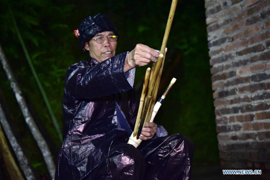 Craftsman Liang Jianzhong installs bamboo pipes on a wooden blowing tube at Jinying Village in Congjiang County of Miao and Dong Autonomous Prefecture of Qiandongnan, southwest China\'s Guizhou Province, on Oct. 16, 2018. Lusheng is an ethnic musical instrument with multiple bamboo pipes set into a wooden blowing tube. It is popular among the people of some ethnic groups living in southwestern China. Jinying Village, known for making Lusheng, still keeps the traditional Lusheng making techniques which include over 30 steps such as choosing material, installing reed and whittling sound hole. People often play the Lusheng while gathering to celebrate some major festivals. (Xinhua/Wu Dejun)