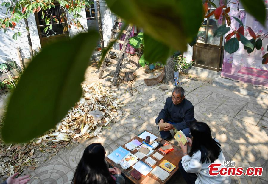 Farmer Jia Zengwen shows a diary he began to write 60 years ago at his home in Niujia Village, Gaocheng City, North China's Hebei Province, Oct. 18, 2018. Jia has filled 108 diaries over the years, and they include records of his first time receiving the subsidy, a medical insurance claim, and the pension. The diaries also provide a record of the change that has taken place in his rural home over the past 40 years of reform and opening up. (Photo: China News Service/Zhai Yujia)