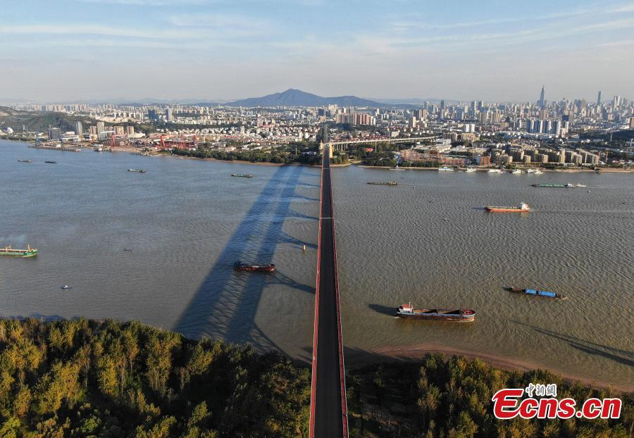 A drone photo shows the Nanjing Yangtze River Bridge, which is undergoing renovation work, in Nanjing City, Jiangsu Province, Oct. 18, 2018. A double-decked road-rail truss bridge across the Yangtze River, it was completed and open for traffic in 1968 and remains one of the most famous landmarks in China. The bridge is set to reopen by the end of the year. (Photo: China News Service/Yang Bo)