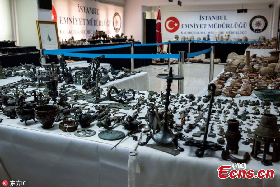 Photo taken on Oct. 19, 2018 shows historical artifacts confiscated in anti-smuggling operations in Istanbul, Turkey. The Istanbul Police Department\'s Anti-Smuggling Crime Branch teams carried out the biggest seizure of historical artifacts in the history of the republic, with raids across 12 Turkish provinces, recovering 14,000 historical pieces and bags full of foreign currency as well as Turkish lira. (Photo/IC)