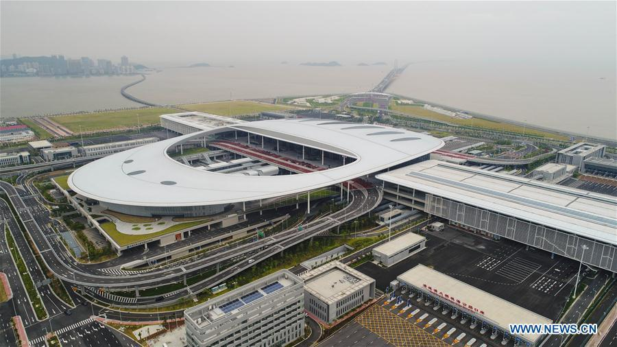 Aerial photo shows the Zhuhai Port of Hong Kong-Zhuhai-Macao Bridge in Zhuhai, south China\'s Guangdong Province, Oct. 11, 2018. Customs clearance between Macao and Zhuhai will be carried out on a \