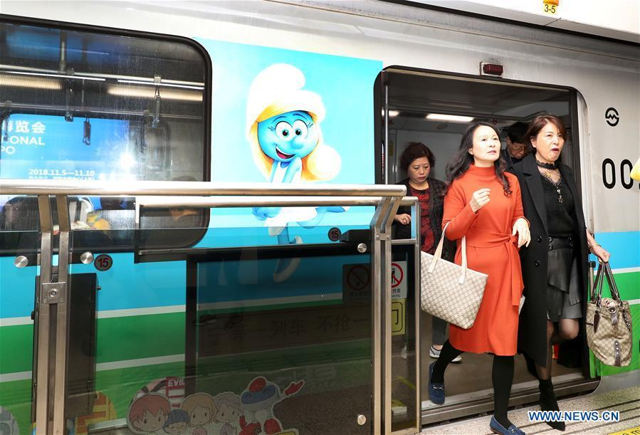 Passengers get off a China-Belgium theme train of Shanghai Metro Line 2 bearing a character image from Belgian comic \