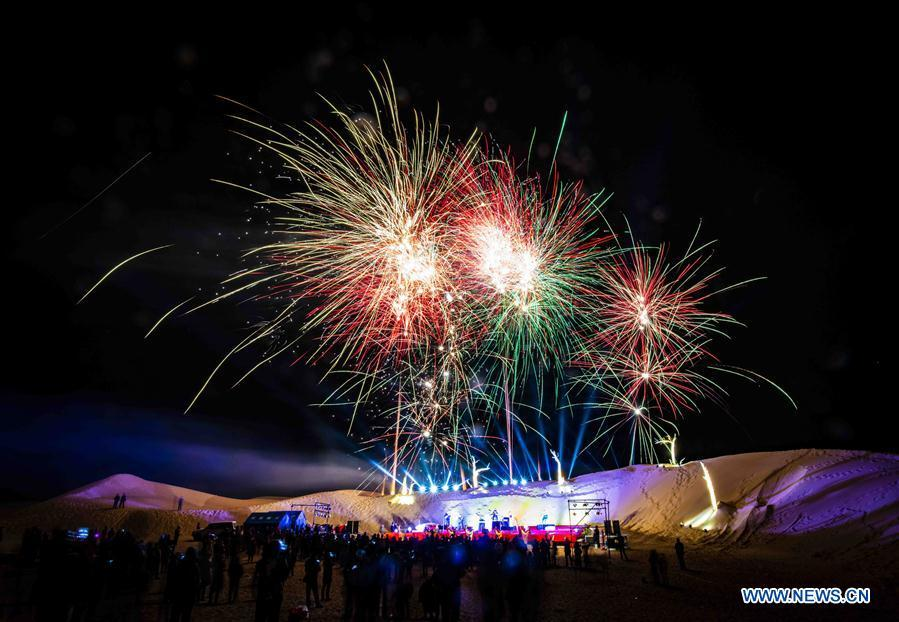 Fireworks are seen during a desert-themed concert held in Qiemo County in the Mongolian Autonomous Prefecture of Bayingolin, northwest China\'s Xinjiang Uygur Autonomous Region, Oct. 20, 2018. (Xinhua/Zhao Ge)