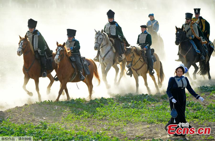 Riders arrive during the reconstruction of the Battle of the Nations at the 205th anniversary near Leipzig, Germany, Oct. 20, 2018. The Battle of Leipzig or Battle of the Nations, on 16?19 October 1813, was fought by the coalition armies of Russia, Prussia, Austria and Sweden against the French army of Napoleon. The battle decided that Napoleon had to retreat to France, the beginning of his downfall. (Photo/Agencies)