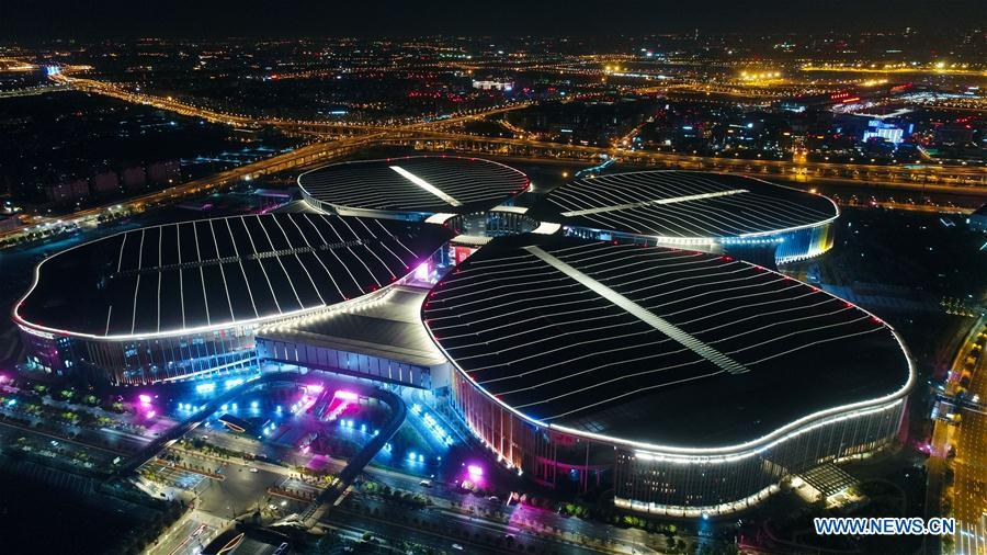 Photo taken on Oct. 21, 2018 shows a night view of the National Exhibition and Convention Center (Shanghai) in Shanghai, east China. The six-day China International Import Expo (CIIE) will be opened in the center on Nov. 5. (Xinhua/Ding Ting)
