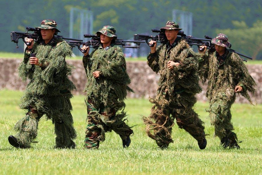 The PLA Navy Marine Corps members return from sniper training. (PHOTO/CHINA DAILY)