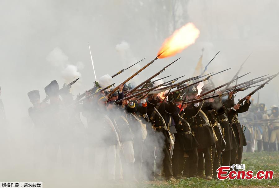 Troops fight during the reconstruction of the Battle of the Nations at the 205th anniversary near Leipzig, Germany, Oct. 20, 2018. The Battle of Leipzig or Battle of the Nations, on 16?19 October 1813, was fought by the coalition armies of Russia, Prussia, Austria and Sweden against the French army of Napoleon. The battle decided that Napoleon had to retreat to France, the beginning of his downfall. (Photo/Agencies)