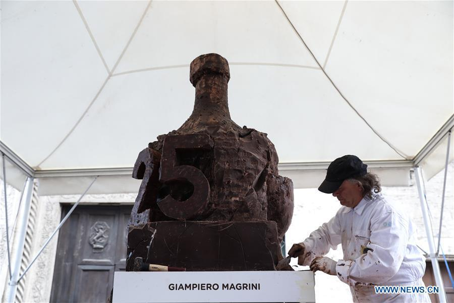 An artist sculpts chocolate during the 25th international chocolate festival \