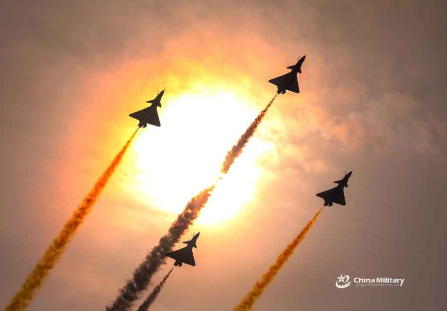 Four J-10 fighter jets attached to the August 1st Aerobatics Team of the Chinese People\'s Liberation Army (PLA) Air Force perform aerobatic stunts during the aviation open day at an airport in North China on October 20, 2018. (Photo/eng.chinamil.com.cn)