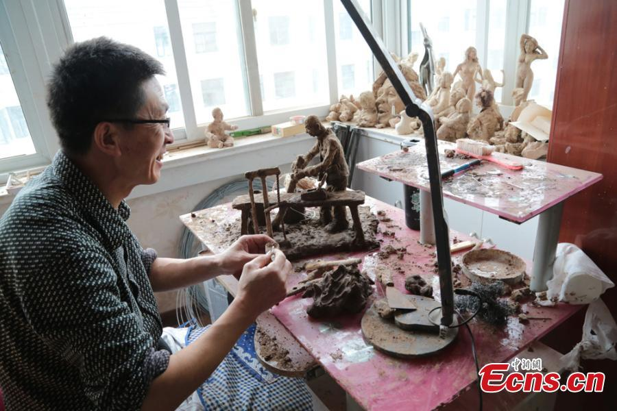 Clay sculpture enthusiast Zhao Tiejun gives the final touch on creations featuring past rural life and farming traditions in his home in Pingliang City, Northwest China's Gansu Province, Oct. 23, 2018. Zhao has been fascinated with the hobby of making clay figurines for two decades as he believes the handicraft can help younger generation learn about the countryside life now increasingly transformed. (Photo: China News Service/Zheng Bing)