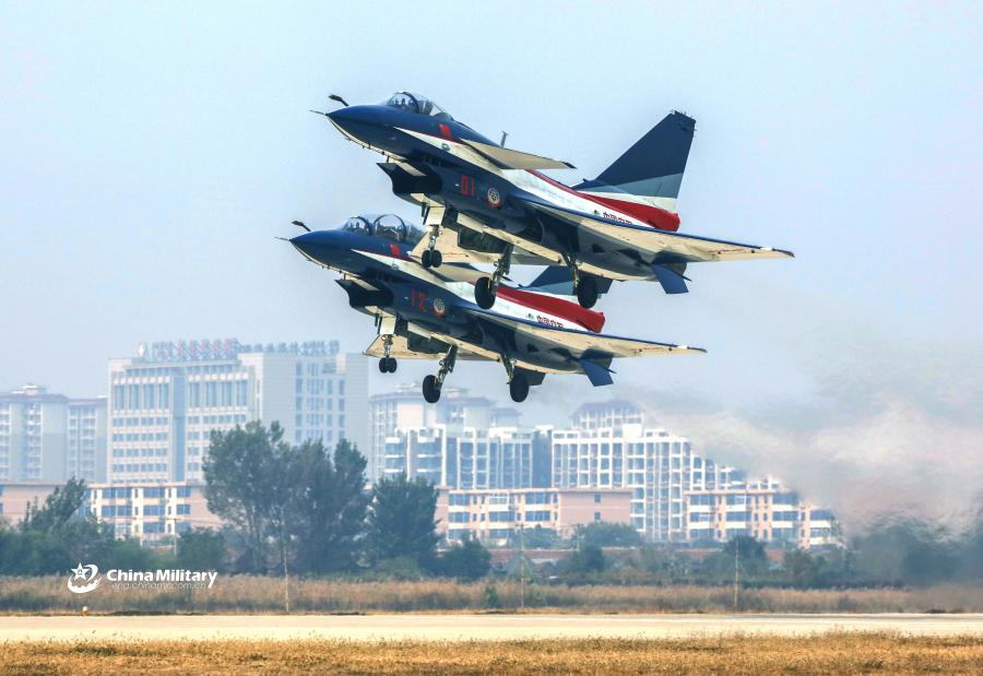 Two J-10 fighter jets attached to the August 1st Aerobatics Team of the Chinese People\'s Liberation Army (PLA) Air Force take off during the aviation open day at an airport in North China on October 20, 2018. (Photo/eng.chinamil.com.cn)
