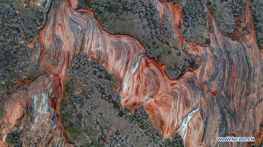 Aerial photo taken on Oct. 21, 2018 shows a view of Danxia landform at Wangjiawan of Pingqiao Town in Ansai District of Yan\'an, northwest China\'s Shaanxi Province. Danxia landform is a unique type of geomorphology formed from red-colored sandstones and characterized by steep cliffs. (Xinhua/Tao Ming)