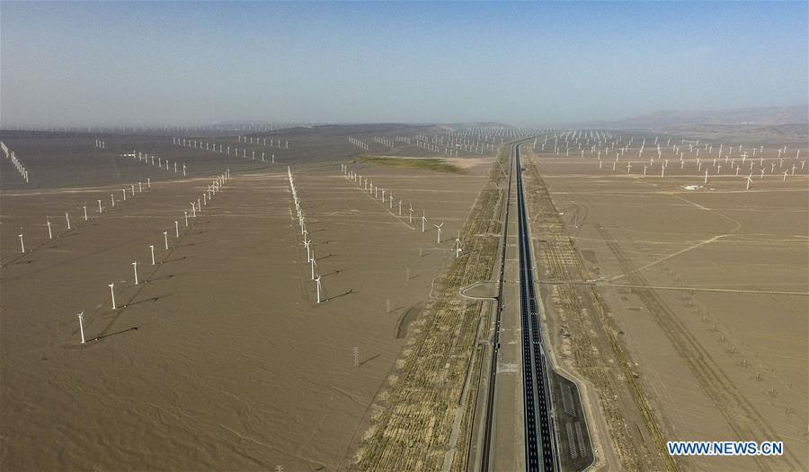 Aerial photo taken on Sept. 22, 2018 shows a wind power plant in Turpan, northwest China\'s Xinjiang Uygur Autonomous Region. Xinjiang has seen a surge in the electricity generation from clean energy. According to State Grid Xinjiang Electric Power Co., Ltd., wind and solar power generated 27.81 billion and 9.07 billion kilowatt hours (kwh) of electricity, respectively, in the first nine months of 2018 in the region. With abundant wind and solar resources, Xinjiang is a pioneer in using new energy in China, with installed new-energy capacity having exceeded 27 million kilowatts so far. (Xinhua/Zhao Ge)