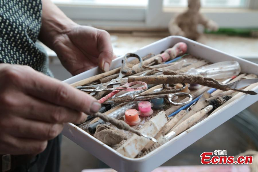 Clay sculpture enthusiast Zhao Tiejun shows his tools to make creations featuring past rural life and farming traditions in his home in Pingliang City, Northwest China's Gansu Province, Oct. 23, 2018. Zhao has been fascinated with the hobby of making clay figurines for two decades as he believes the handicraft can help younger generation learn about the countryside life now increasingly transformed. (Photo: China News Service/Zheng Bing)