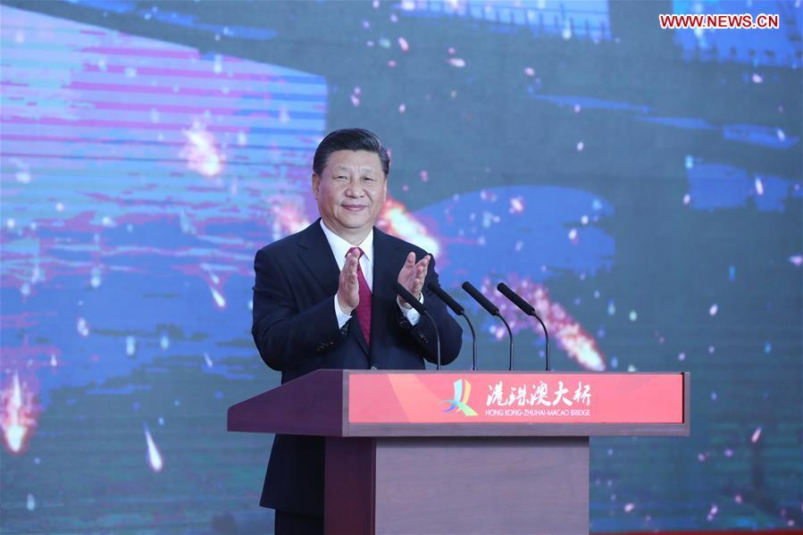Chinese President Xi Jinping, also general secretary of the Communist Party of China Central Committee and chairman of the Central Military Commission, announces the opening of the Hong Kong-Zhuhai-Macao Bridge at an opening ceremony in Zhuhai, south China\'s Guangdong Province, Oct. 23, 2018. (Xinhua/Ju Peng)