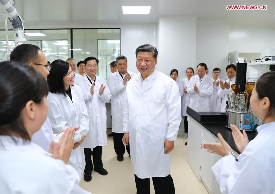 Chinese President Xi Jinping, also general secretary of the Communist Party of China Central Committee and chairman of the Central Military Commission, visits the Traditional Chinese Medicine Science and Technology Industrial Park of Co-operation between Guangdong and Macao in Zhuhai, south China\'s Guangdong Province, Oct. 22, 2018. Xi made an inspection tour in Zhuhai on Monday. (Xinhua/Xie Huanchi)