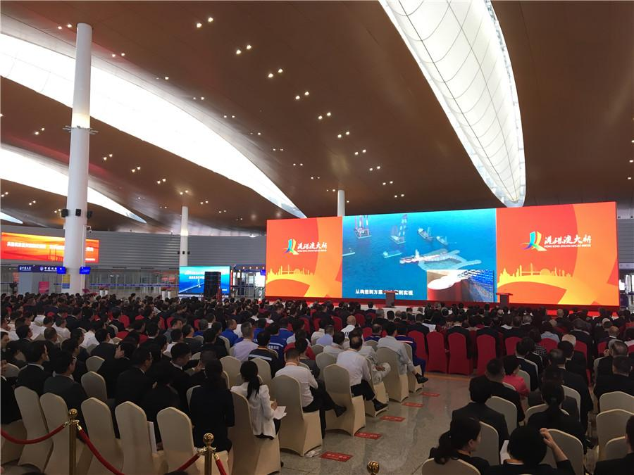 The attendees of the Hong Kong-Zhuhai-Macao Opening Ceremony wait patiently in their seats as the event will soon begin Tuesday morning. (Photo by He Shusi/China Daily)