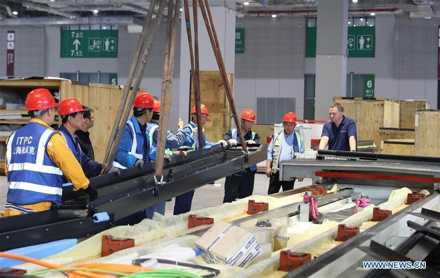 Staff members work at the assembly site of Taurus milling machine in Shanghai, east China, Oct. 17, 2018. Preliminary assembly of the milling machine, which will be the largest exhibit to be on show at China\'s upcoming import expo, was finished here on Monday. The exhibit is expected to cover 200 square meters of exhibiting space during the expo, which is scheduled to be held in Shanghai on Nov. 5-10. (Xinhua/Fang Zhe)