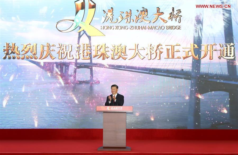Chinese President Xi Jinping, also general secretary of the Communist Party of China Central Committee and chairman of the Central Military Commission, announces the opening of the Hong Kong-Zhuhai-Macao Bridge at an opening ceremony in Zhuhai, south China\'s Guangdong Province, Oct. 23, 2018. (Xinhua/Xie Huanchi)