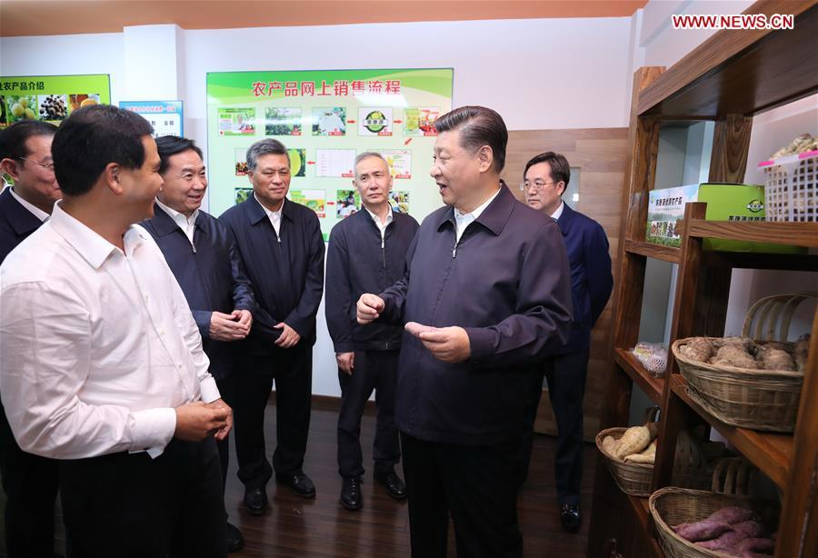 Chinese President Xi Jinping, also general secretary of the Communist Party of China Central Committee and chairman of the Central Military Commission, visits an e-commerce industrial park in Yingde of Qingyuan City, south China\'s Guangdong Province, during an inspection tour, Oct. 23, 2018. (Xinhua/Ju Peng)