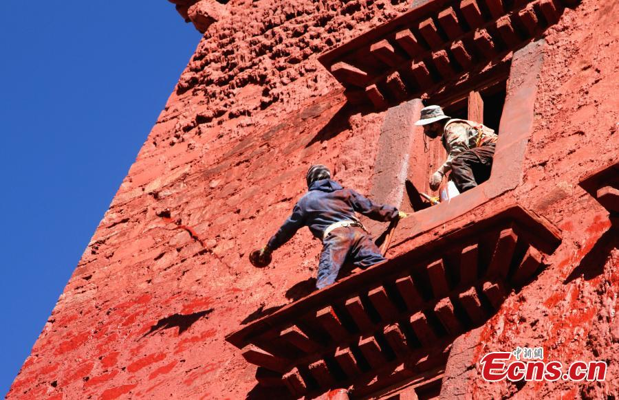 Workers paint the Potala Palace.