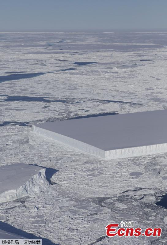 Photo by NASA shows a rectangular iceberg spotted off the east coast of the Antarctic Peninsula, near the Larsen C ice shelf. NASA experts say the sharp angles and flat surfaces are evidence the break occurred very recently. (Photo/NASA)