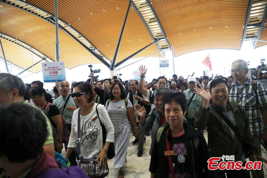 Passengers wait at the Passenger Clearance Building in Hong Kong to board coaches that will pass over the Hong Kong-Zhuhai-Macao Bridge, Oct. 24, 2018. (Photo: China News Service/Xie Guanglei)