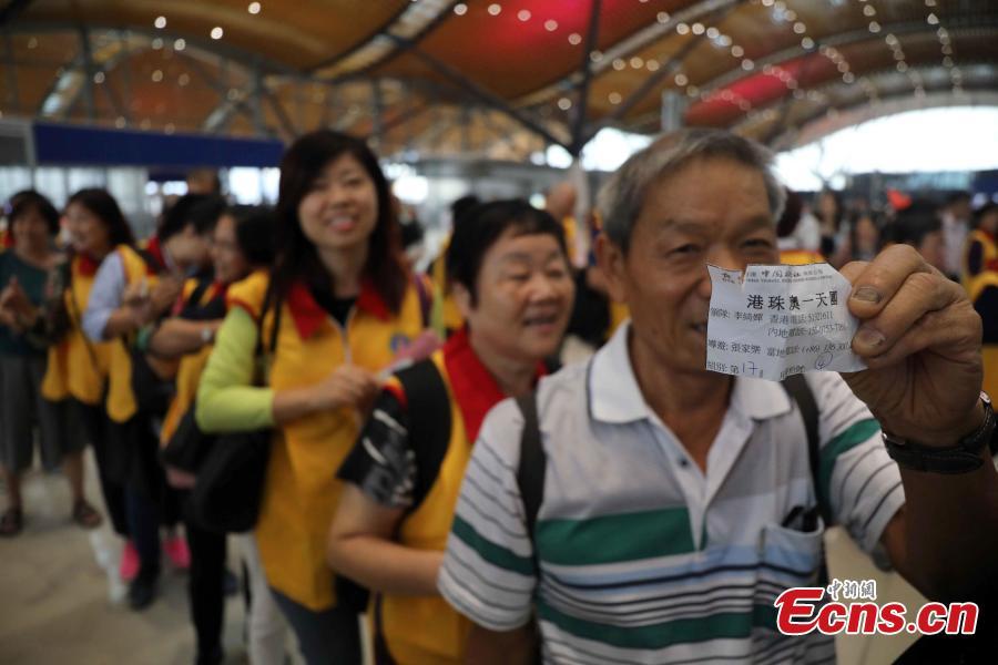 Passengers wait at the Passenger Clearance Building in Hong Kong to board coaches that will pass over the Hong Kong-Zhuhai-Macao Bridge, Oct. 24, 2018. (Photo: China News Service/Sheung Man Mak)