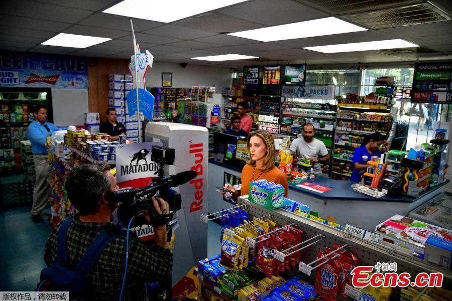 A TV news crew films a segment inside the KC Mart in Simpsonville, South Carolina, U.S., Oct. 24, 2018. (Photo/Agencies)