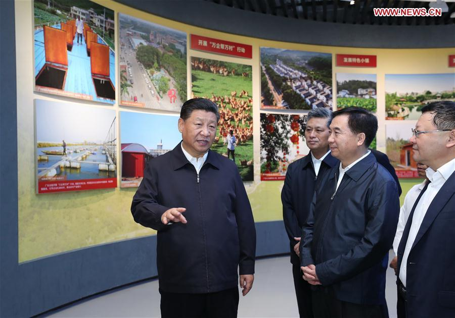 Chinese President Xi Jinping, also general secretary of the Communist Party of China Central Committee and chairman of the Central Military Commission, visits an exhibition on Guangdong\'s development during the past 40 years since the reform and opening up at a museum in Shenzhen, south China\'s Guangdong Province, during an inspection tour, Oct. 24, 2018. (Xinhua/Ju Peng)