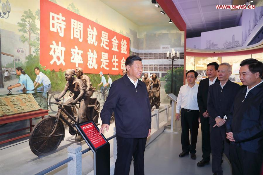 Chinese President Xi Jinping, also general secretary of the Communist Party of China Central Committee and chairman of the Central Military Commission, visits an exhibition on Guangdong\'s development during the past 40 years since the reform and opening up at a museum in Shenzhen, south China\'s Guangdong Province, during an inspection tour, Oct. 24, 2018. (Xinhua/Xie Huanchi)