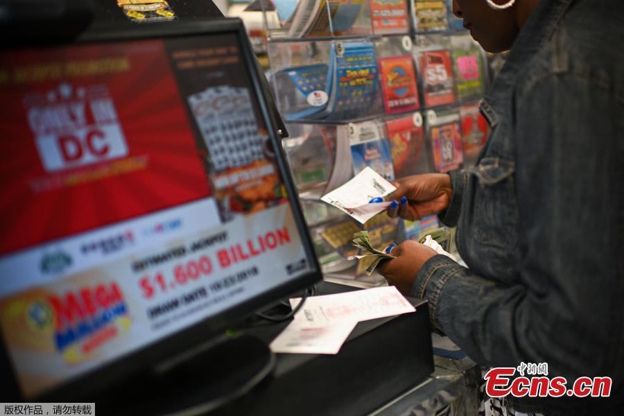 A sign advertising tickets for the $1.6 billion Mega Millions lottery drawing. (Photo/Agencies)