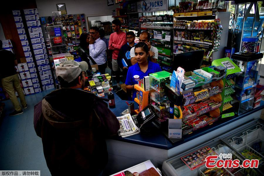 Twinkle Patel interacts with a regular customer at the KC Mart in Simpsonville, South Carolina, U.S., Oct. 24, 2018.(Photo/Agencies)