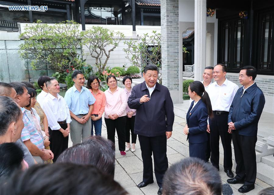Chinese President Xi Jinping, also general secretary of the Communist Party of China Central Committee and chairman of the Central Military Commission, visits the Xiguan historical and cultural community in Liwan District of Guangzhou, capital of south China\'s Guangdong Province, during an inspection tour, Oct. 24, 2018. (Xinhua/Xie Huanchi)