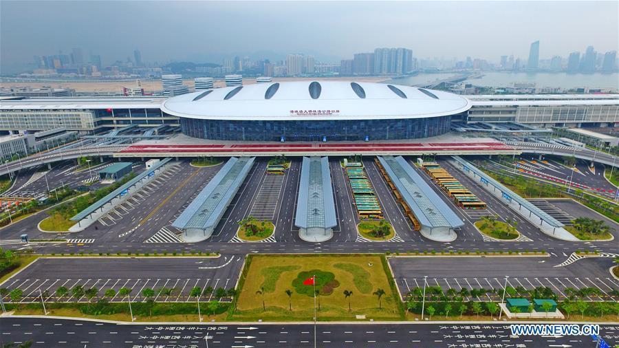 Aerial photo taken on Oct. 24, 2018 shows the Zhuhai Port of the Hong Kong-Zhuhai-Macao Bridge in Zhuhai, south China\'s Guangdong Province. The Hong Kong-Zhuhai-Macao bridge, the world\'s longest cross-sea bridge, opened to public traffic at 9 a.m. Wednesday. (Xinhua/Liang Xu)