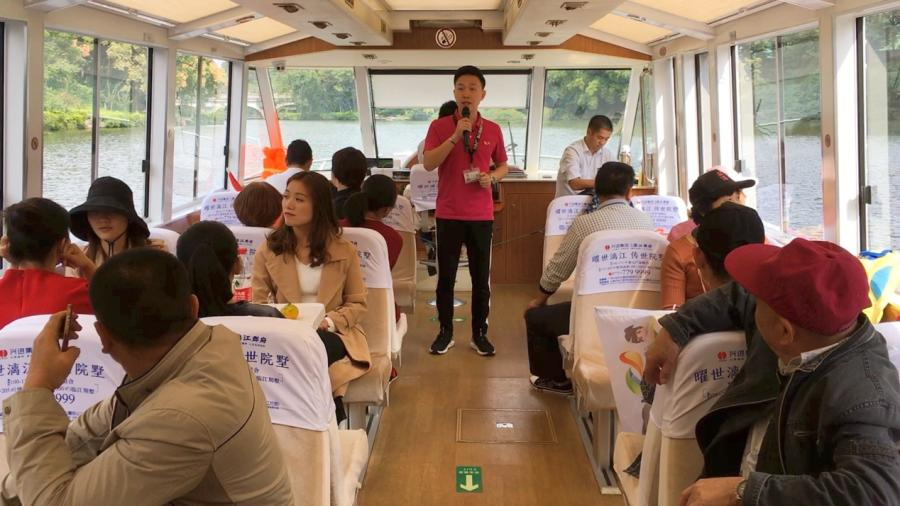 Wei Zhenfeng, a tour guide in Guilin, guides visitors on a sightseeing cruise. (Photo/CGTN)  The 29-year-old man, who was named among Guilin\'s top ten tour guides in 2016, was part of China\'s 2017 national plan for tourism professionals. As a Guilin native, he\'s received tens of thousands of tourists, but never gets tired of describing Guilin\'s beauty to his guests.  The rivers and lakes in the city used to be separated. They were connected in 2002 when the city established a ring river system, and made it a special feature of Guilin. It came as part of efforts made by the local government to protect the river and preserve the city\'s reputation.
