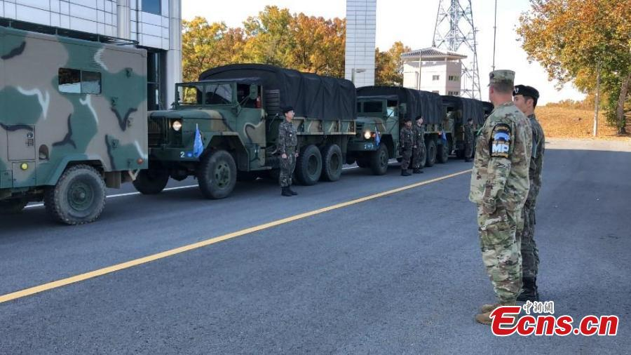 In this photo provided by South Korea Defense Ministry, a U.S. and a South Korean army soldiers stand before leaving from the border village of Panmunjom, South Korea, Oct. 25, 2018. Koreas completed withdrawing firearms and troops from a jointly controlled area at the Koreas\' border village on Thursday as part of their sweeping agreements to reduce decades-long military animosities on the Korean Peninsula. (Photo/Agencies)