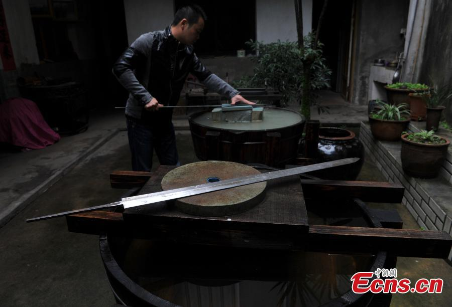 "A sword-making workshop in Songxi County in East China's Fujian Province. Zhanlu Mountain in southern Songxi, well-known for its long history and strong culture, is said to have been the home to the most revered among top five most famous swords in ancient China. Chinese poets in the Tang and Song dynasties, including Du Fu, Li Bai and Su Shi, penned lines in praise of the Zhanlu swords, nicknamed as the ""No. 1 Sword Under the Heaven"". In 1985, local craftsmen went to huge efforts, reading historical literature and working with research institutes in Beijing and Nanjing, to finally craft Zhanlu swords by hand again. Making a Zhanlu sword involves more than 100 time-consuming steps, including forging, quenching and grinding. (Photo: China News Service/Zhang Bin)"