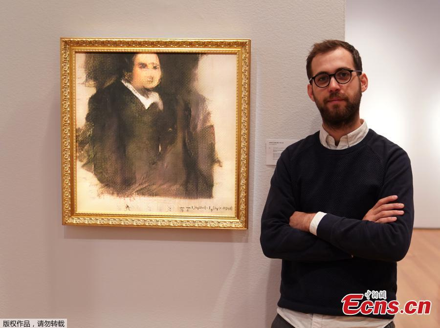 Pierre Fautrel, Co Founder of the team of French entrepreneurs called OBVIOUS which produces art using artificial intelligence, stands next to a work of art created by an algorithm titled \